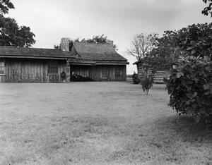 Primary view of object titled '[Reuben Bennett House, (Log cabin at right is 402256)]'.
