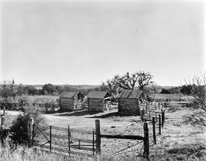 Primary view of object titled '[3 Log Cribs, (Northwest oblique)]'.