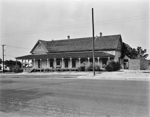 Primary view of object titled '[Annie Riggs Hotel, (West elevation)]'.