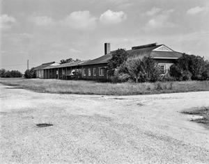 Primary view of object titled '[Blimp Base Laundry and Station Main, (Northwest facade)]'.