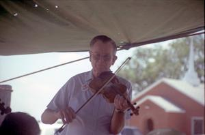 Primary view of object titled '[Fiddler at the Dawn Community 100th Birthday Celebration]'.