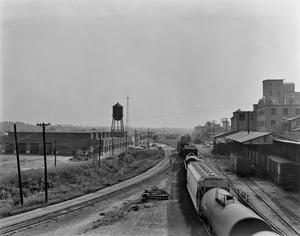 Primary view of object titled '[Railroad, (View East - Railroad shops and water tower)]'.