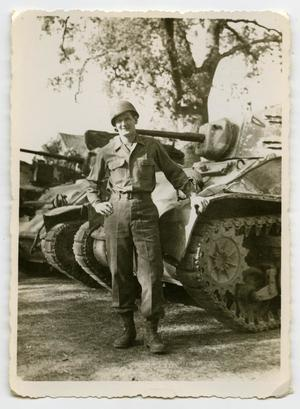 Primary view of object titled '[A Soldier LeaningAgainst a Tank]'.