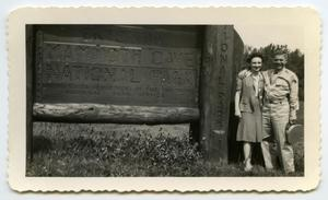 Primary view of object titled '[Photograph of a Couple at The Mammoth Cave National Park Sign]'.
