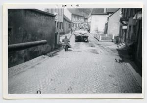 Primary view of object titled '[Photograph of a German Prisoner Running up a Hill]'.
