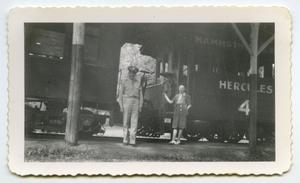 Primary view of object titled '[Photograph of a Soldier and a Lady by a Caboose]'.