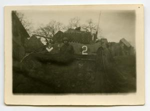 Primary view of object titled '[A Soldier Standing Against the Side of a Tank]'.