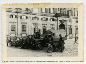 Primary view of object titled '[German Soldiers Standing Next to Trucks and Motorcycles]'.
