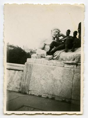 Primary view of object titled '[Two Soldiers Sitting on a Monument]'.