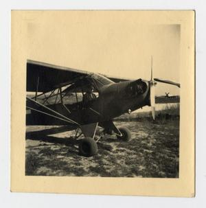 Primary view of object titled '[Photograph of Soldier in Airplane]'.