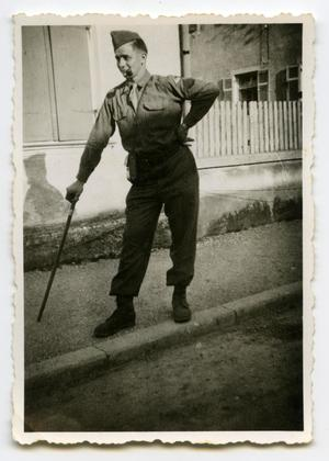 Primary view of object titled '[A Soldier Walking Using a Cane]'.