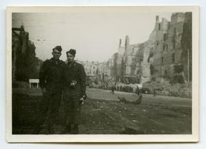Primary view of object titled '[Two Soldiers Standing in the Street]'.
