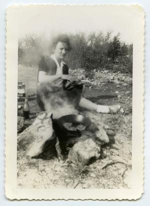 Primary view of object titled '[Photograph of a Lady by a Cooking Fire]'.