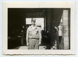 Primary view of object titled '[Photograph of a Soldier near a Garage]'.