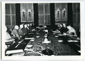 Primary view of object titled '[Adolf Hitler Sitting at a Conference Table]'.