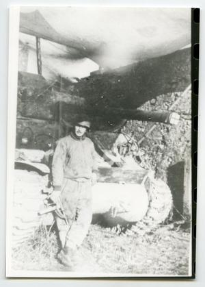 Primary view of object titled '[A Soldier Standing Up Against a Tank]'.