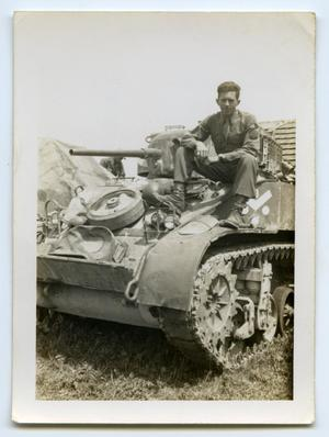 Primary view of object titled '[A Soldier Sitting on the Front of a Tank]'.