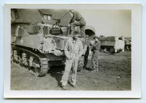 Primary view of object titled '[Four Soldiers Stand by an Armored Vehicle]'.
