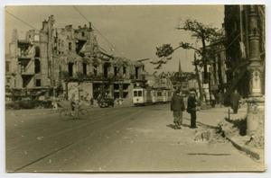 Primary view of object titled '[Looking Down a Battered Street]'.