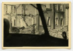 Primary view of object titled '[Photograph of People Near Ruined Building]'.