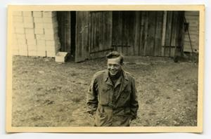 Primary view of object titled '[Photograph of Soldier in Yard]'.