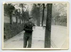 Primary view of object titled '[A Soldier Standing by a Sign]'.