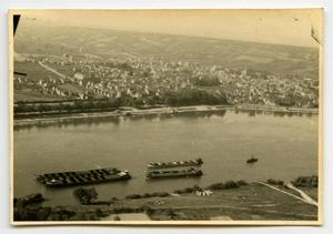 Primary view of object titled '[Photograph of Town by River]'.