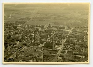 Primary view of object titled '[Aerial Photograph of Damaged Town]'.
