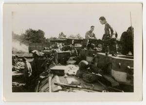 Primary view of object titled '[Soldiers Fixing Their Equipment]'.