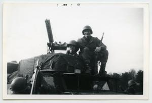 Primary view of object titled '[Photograph of Two Soldiers on a Tank]'.