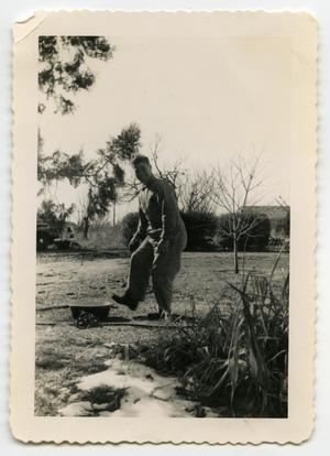 Primary view of object titled '[Photograph of a Soldier in a Yard]'.