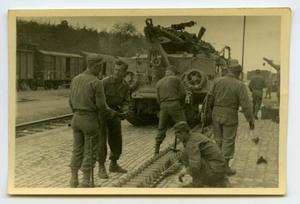 Primary view of object titled '[Photograph of Soldiers Working on Tank]'.