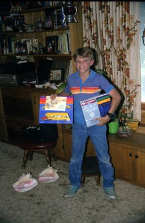 Primary view of object titled '[Boy with Birthday Gifts]'.