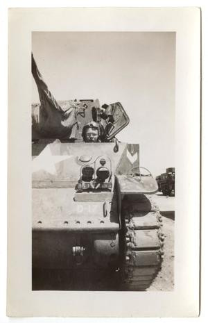 Primary view of object titled '[A Soldier Sitting in a Tank]'.