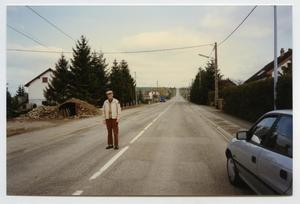 Primary view of object titled '[Photograph of a Man Standing on a Road]'.