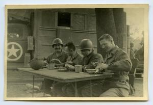 Primary view of object titled '[Photograph of Soldiers Eating Together]'.