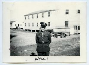 Primary view of object titled '[Photograph of a Soldier near a Cabin]'.