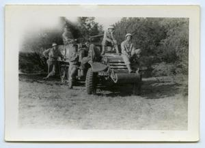 Primary view of object titled '[Photograph of Soldiers on a Vehicle]'.