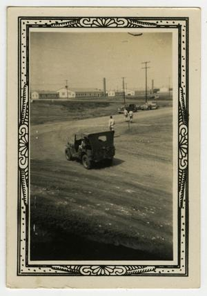 Primary view of object titled '[Jeep on Curve of Dirt Road]'.