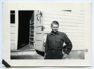 Primary view of object titled '[Photograph of a Soldier at a Cabin]'.