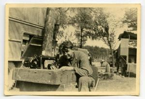 Primary view of object titled '[Photograph of Soldier Sewing]'.