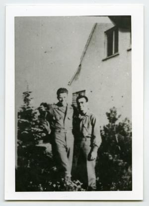 Primary view of object titled '[Two Soldiers Stand for a Picture Behind a House]'.