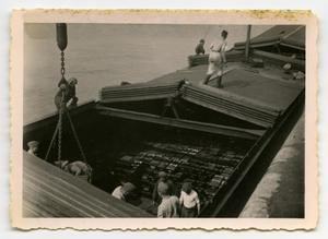 Primary view of object titled '[Soldiers Working on a Transport Ship Filled with Ammunition]'.