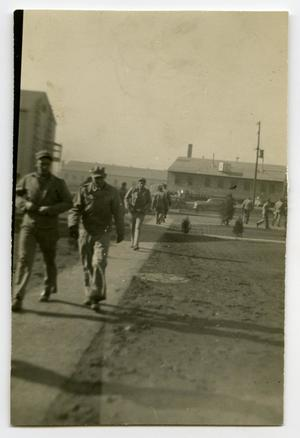 Primary view of object titled '[Soldiers Walking Around the Barracks Area]'.