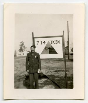 Primary view of object titled '[A Soldier Standing in Front of a Sign]'.