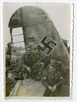 Primary view of object titled '[Four Soldiers Sitting on a Broken Airplane]'.