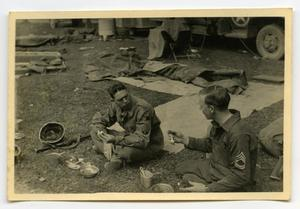 Primary view of object titled '[Photograph of Soldiers Eating]'.