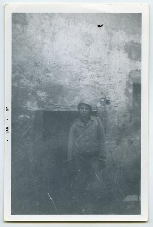 Primary view of object titled '[Photograph of a Soldier in front of a Bunker]'.