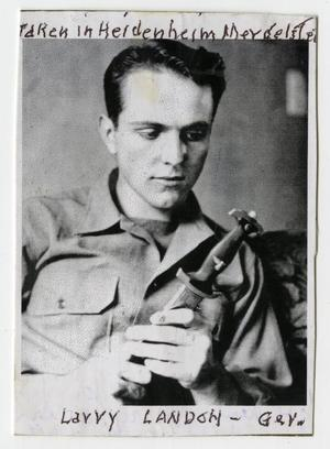 [Photograph of Larry Landon with Knife]
