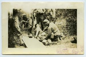 Primary view of object titled '[A Soldier Receiving First Aid to the Rear]'.